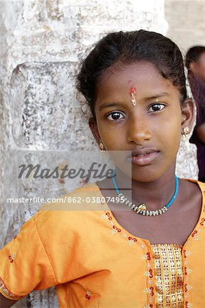 India, Tamil Nadu. Portrait of an Indian girl at the Minakshi Sundareshvara Temple. Stock Photo - Rights-Managed, Image code: 862-03807495