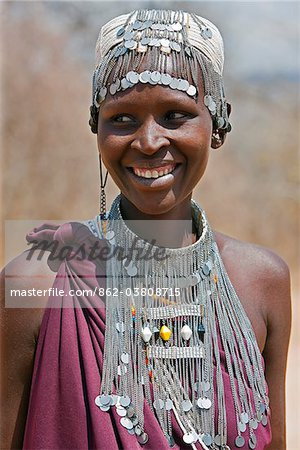 A Maasai girl from the Kisongo clan wearing an attractive beaded headband and necklace. Stock Photo - Rights-Managed, Image code: 862-03808715