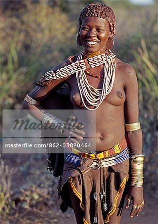 A Hamar girl in traditional attire.The Hamar are an attractive people with striking styles and clothes. Skins are widely used for clothing and cowrie shells are popular adornments yet the sea is 500 miles from their home. Stock Photo - Rights-Managed, Image code: 862-03820464