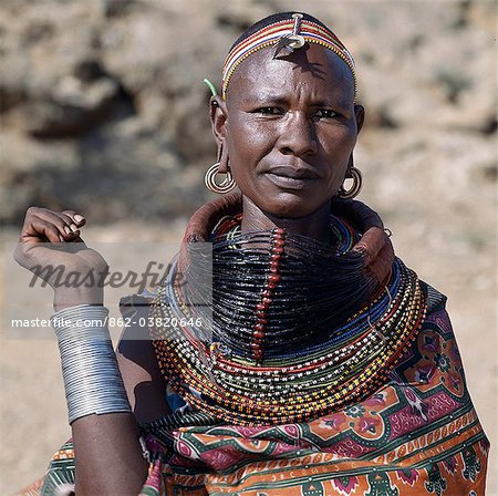 A Samburu woman wearing a mporro necklace, which denotes her married status. These necklaces were once made of hair from giraffe tails but nowadays, the fibres of doum palm fronds, Hyphaene coriacea, are used instead.The red beads after which the necklace is named are wound glass beads made in Venice c.1850. Stock Photo - Rights-Managed, Image code: 862-03820646
