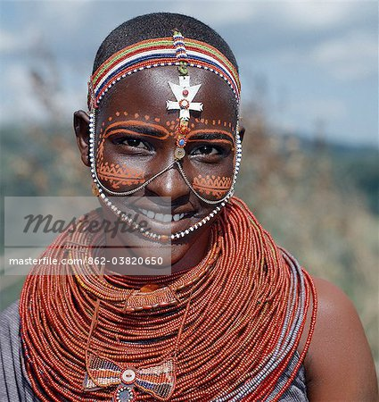 Samburu girls are given strings of beads by their fathers when they are still young. As soon as they are old enough to have lovers from the warrior age set, they regularly receive gifts from them.Over a period of years, their necklaces can smother them up to their necks. Stock Photo - Rights-Managed, Image code: 862-03820650