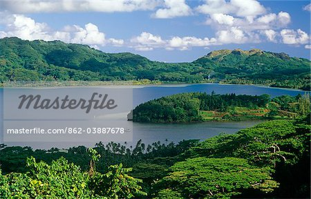 French Polynesia, Society Islands, Leeward Islands, Huahine Island, aka Matairea. Lush forests surround the deeply incised Maroe Bay which divides the island into Big Huahine, Huahine Nui, and Little Huahine,Huahine Iti. Stock Photo - Rights-Managed, Image code: 862-03887678