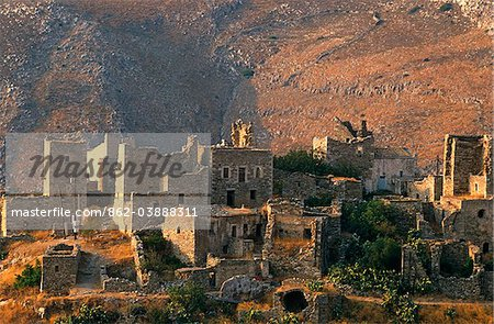 Greece, Peloponnese, Laconia, Mani, Vathia. The part-ruined village of Vathia is a fine example of the traditional tower house architecture that dominated this wild and once inaccessible region.