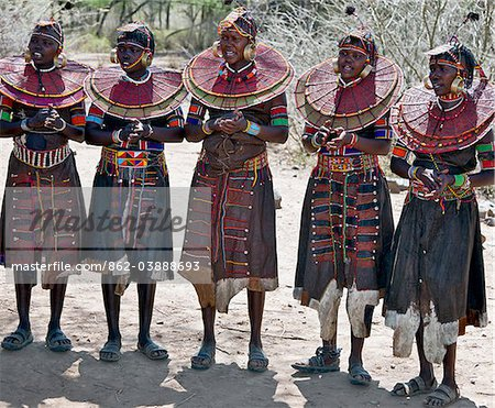 Pokot women wearing traditional beaded ornaments and brass earrings denoting their married status. celebrate an Atelo ceremony. The Pokot are pastoralists speaking a Southern Nilotic language. Stock Photo - Rights-Managed, Image code: 862-03888693
