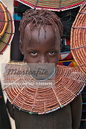 A young Pokot girl wearing a traditional broad necklace made of hollow reed grass that denotes her uninitiated status. The Pokot are pastoralists speaking a Southern Nilotic language. Stock Photo - Rights-Managed, Image code: 862-03888699