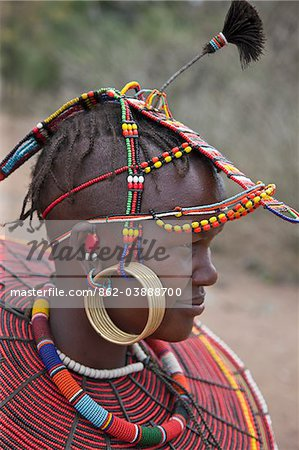 A young married Pokot woman wearing the traditional beaded ornaments of her tribe which denote her married status. The Pokot are pastoralists speaking a Southern Nilotic language. Stock Photo - Rights-Managed, Image code: 862-03888700