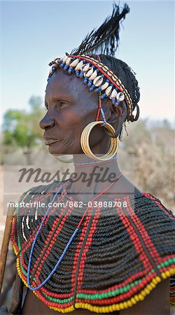 A striking old Pokot woman wearing the traditional beaded ornaments of her tribe which denote her married status. The Pokot are pastoralists speaking a Southern Nilotic language. Stock Photo - Rights-Managed, Image code: 862-03888708