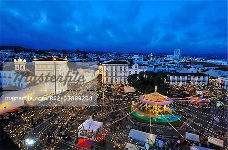 The Holy Christ church and Campo de Sao Francisco during the Holy Christ festivities at Ponta Delgada, in twilight. Sao Miguel, Azores islands, Portugal
