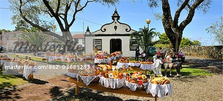 Holy Spirit (Espirito Santo) festivities at Bandeiras. This kind of bread, called Vesperas, is a delicacy. Pico, Azores islands, Portugal Stock Photo - Rights-Managed, Image code: 862-03889233