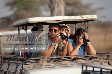 Safari tourists watching game on the Serengeti in Tanzania Stock Photo - Rights-Managed, Image code: 862-03890068