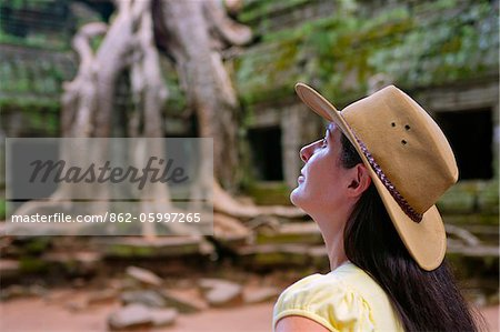 Cambodia, Angkor, Siem Reap, Ta Prohm Temple, Woman exploring Stock Photo - Rights-Managed, Image code: 862-05997265