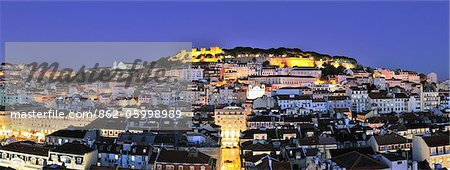 The historical centre and the Sao Jorge castle at dusk. Lisbon, Portugal Stock Photo - Rights-Managed, Image code: 862-05998989