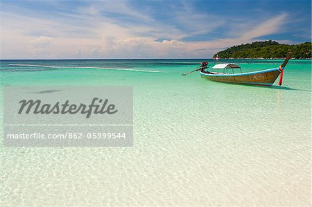 Thailand, Satun Province, Koh Lipe. A boat moored off Pattaya Beach. Stock Photo - Rights-Managed, Image code: 862-05999544