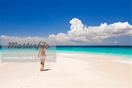 Tanzania, Zanzibar, Unguja, Niamembe Island. A woman walks towards the sea. MR. Stock Photo - Rights-Managed, Image code: 862-05999572