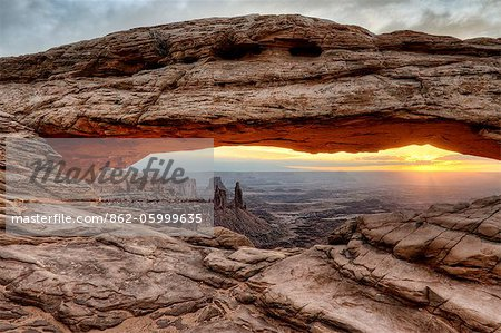 U.S.A., Utah, Canyonlands National Park, Mesa Arch at sunrise. Stock Photo - Rights-Managed, Image code: 862-05999635