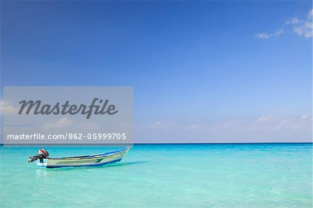 Yemen, Socotra, Sha'ab. A boat moored in the sea at Sha'ab. Stock Photo - Rights-Managed, Image code: 862-05999705