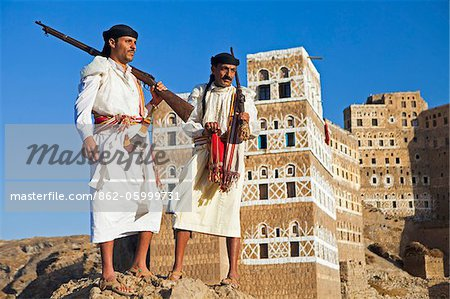 Yemen, Sana'a Province, Haraz Mountains, Jebel Shugruf. Two Yemeni men in traditional dress watching the landscape. Stock Photo - Rights-Managed, Image code: 862-05999731