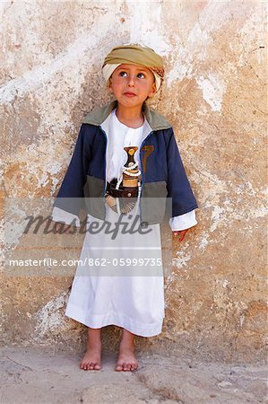 Yemen, Sana'a Province, Haraz Mountains, Al Hajjarah. A boy stands against a wall. Stock Photo - Rights-Managed, Image code: 862-05999735