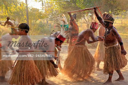 South America, Brazil, Miranda, Terena indigenous people from the Brazilian Pantanal performing a ritual stick dance in grass skirts Stock Photo - Rights-Managed, Image code: 862-06540981
