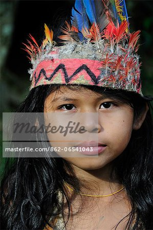 Ticuna girl with head dress, Ticuna Indian Village of Macedonia, Amazon River,near Puerto Narino, Colombia Stock Photo - Rights-Managed, Image code: 862-06541043
