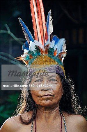 Indian woman with head dress, Ticuna Indian Village of Macedonia, Amazon River, near Puerto Narino, Colombia Stock Photo - Rights-Managed, Image code: 862-06541044