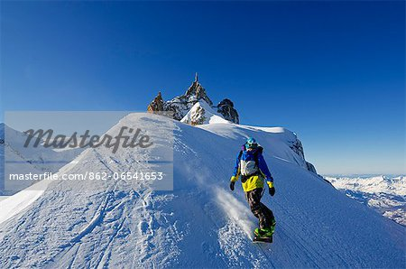 Europe, France, French Alps, Haute Savoie, Chamonix, Aiguille du Midi, snowboarder starting the Vallee Blanche off piste Stock Photo - Rights-Managed, Image code: 862-06541653
