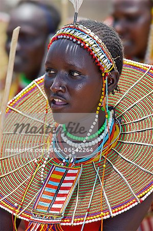 A young Pokot woman sings to celebrate the opening of a new pre primary school at Ngaini, a remote area of the Kerio Valley. Despite her youth, her jewellery denotes she is already married. Stock Photo - Rights-Managed, Image code: 862-06542264