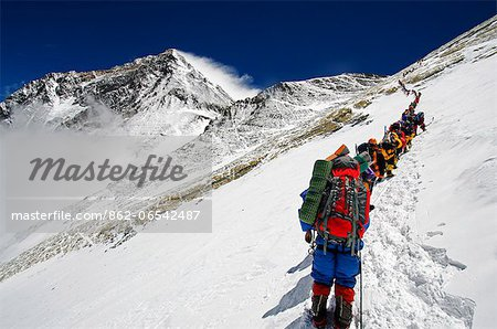 Asia, Nepal, Himalayas, Sagarmatha National Park, Solu Khumbu Everest Region, a line of climbers on the Lhotse Face approaching the Yellow Band with Everest, 8850m, above Stock Photo - Rights-Managed, Image code: 862-06542487