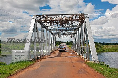 This bridge over a fast flowing river in Central Uganda once formed part of an emergency wartime bridge over the River Thames, Uganda, Africa Stock Photo - Rights-Managed, Image code: 862-06543303