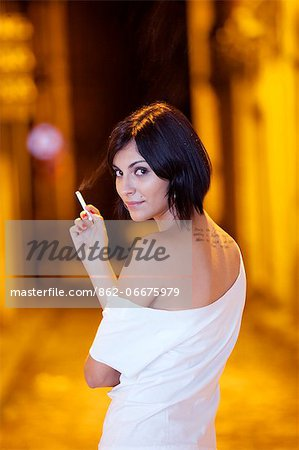 South America, Brazil, Para, Belem, a woman stands with a cigarette in the old colonial part of Belem in the Brazilian Amazon Stock Photo - Rights-Managed, Image code: 862-06675979