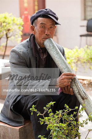 China, Yunnan, Xinping. An elderly man enjoying a peaceful smoke. Stock Photo - Rights-Managed, Image code: 862-06676235