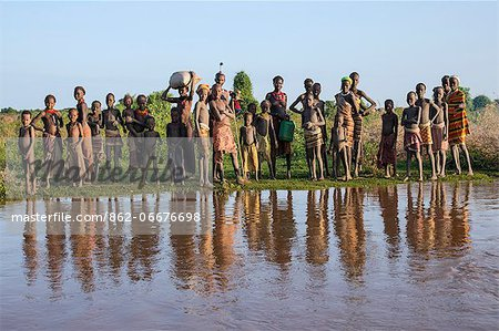 Dassanech villagers line the banks of the Omo River, Ethiopia Stock Photo - Rights-Managed, Image code: 862-06676698