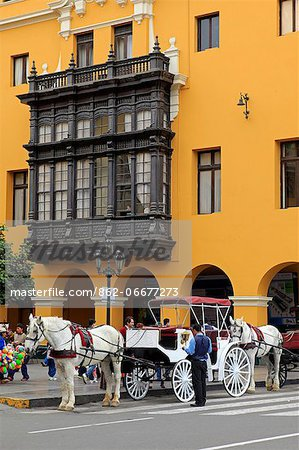 South America, Peru, Lima, a horse and carriage stand in front of a wooden balcony window on the Union Club situated on the main square in the colonial city centre Stock Photo - Rights-Managed, Image code: 862-06677273