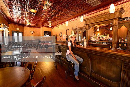 Cowgirl sitting at bar in Old Saloon at Apache Spirit Ranch, Tombstone, Arizona, USA Stock Photo - Rights-Managed, Image code: 862-06677533