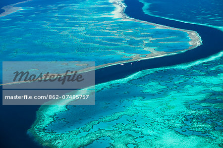 Australia, Queensland, Whitsundays, Great Barrier Reef Marine Park.  Aerial view of The River, a 200 ft deep channel running between Hardys Reef and Hook Reef. Stock Photo - Rights-Managed, Image code: 862-07495757