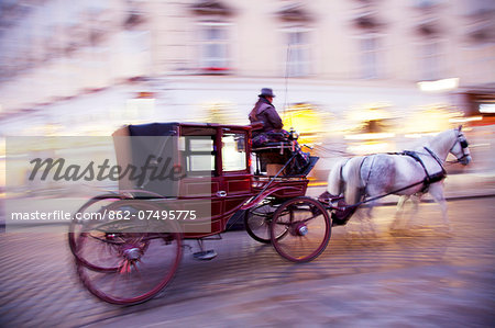 Austria, Vienna. Horse carriage passing through streets in the historical centre Stock Photo - Rights-Managed, Image code: 862-07495775