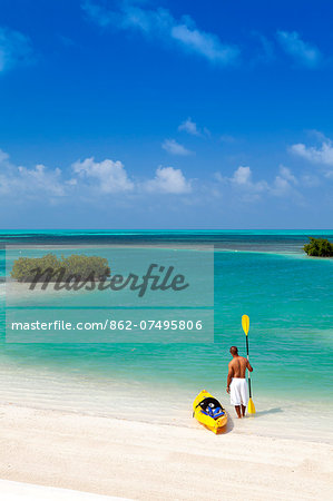 Central America, Belize, Belize district, Little Frenchman Caye, Royal Palm Island, a young man with a kayak looks out to the Caribbean Sea Stock Photo - Rights-Managed, Image code: 862-07495806