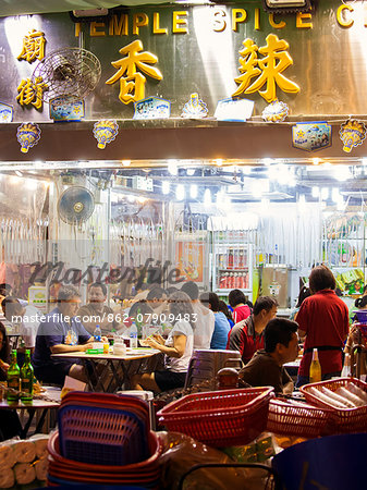 Hong Kong, China. Night view of street with restaurants Stock Photo - Rights-Managed, Image code: 862-07909483