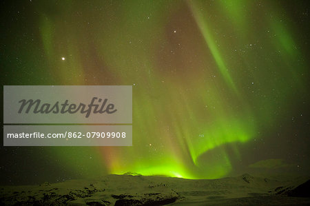 Iceland, Fjallsarlon. The Northern Lights appearing in the sky at Fjallsarlon, a glacier lake at the southern end of the Icelandic glacier of Vatnajokull. Stock Photo - Rights-Managed, Image code: 862-07909908