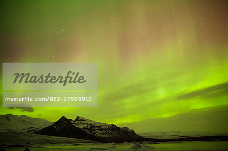 Iceland, Fjallsarlon. The Northern Lights appearing in the sky at Fjallsarlon, a glacier lake at the southern end of the Icelandic glacier of Vatnajokull. Stock Photo - Rights-Managed, Image code: 862-07909910