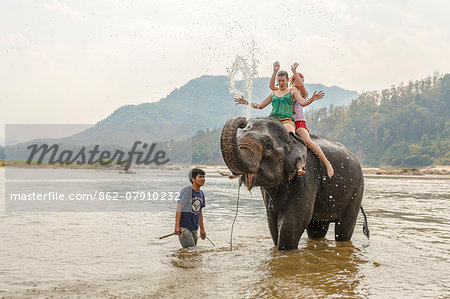 Laos, Luang Prabang. European tourists bathing with an elephant in the Mekong river (MR) Stock Photo - Rights-Managed, Image code: 862-07910232