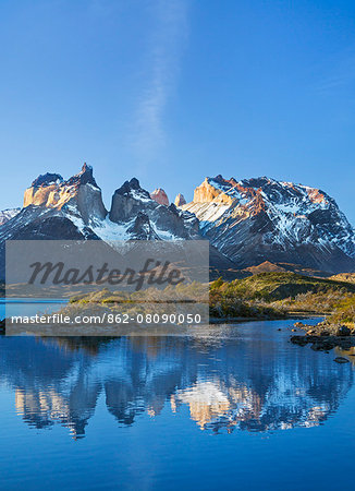 Chile, Torres del Paine, Magallanes Province. The principal attraction of the Torres del Paine National Park is the Paine massif with its granite spires and the contrasting igneous, sedimentary and metamorphic rocks of Ceurnos de Paine. Stock Photo - Rights-Managed, Image code: 862-08090050
