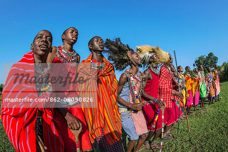 Africa, Kenya, Narok County, Masai Mara. Masai men and women dancing at their homestead. Stock Photo - Rights-Managed, Image code: 862-08090826