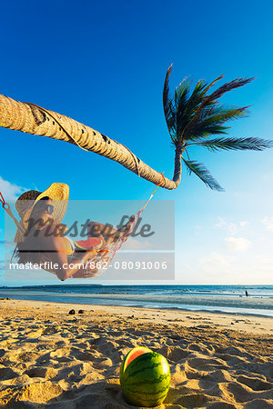 South East Asia, Philippines, The Visayas, Cebu, Bantayan Island, Sugar Beach, girl relaxing on the beach (MR) Stock Photo - Rights-Managed, Image code: 862-08091006