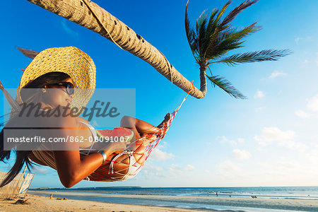 South East Asia, Philippines, The Visayas, Cebu, Bantayan Island, Sugar Beach, girl relaxing on the beach (MR) Stock Photo - Rights-Managed, Image code: 862-08091007