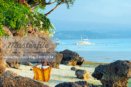 South East Asia, Philippines, The Visayas, Cebu, Moalboal, a girl on Panagsama Beach (MR) Stock Photo - Rights-Managed, Image code: 862-08091034