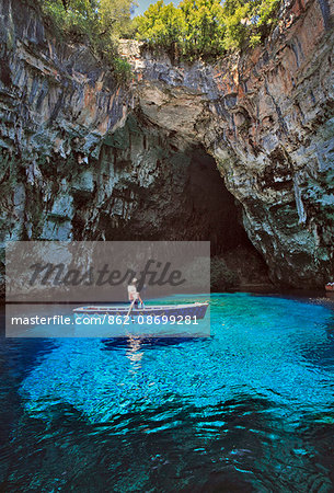Greece, Kefalonia, Sami. Man on a boat at Melissani Cave near Sami. Stock Photo - Rights-Managed, Image code: 862-08699281