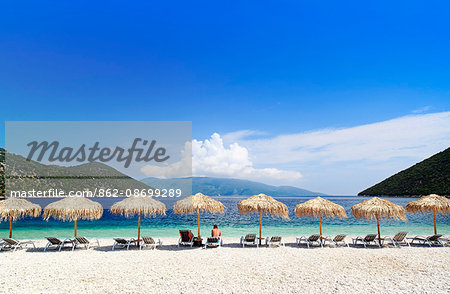 Greece, Kefalonia, Sami. Parsols and sunbeds on Antisamos beach near Sami. Stock Photo - Rights-Managed, Image code: 862-08699289