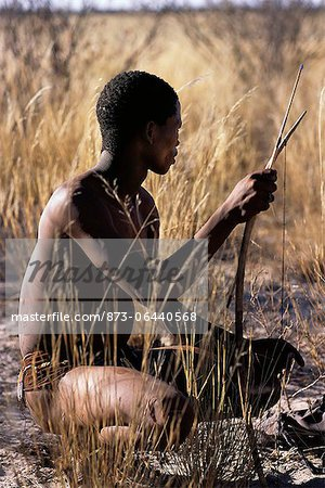 Bushman Hunter Sitting in Field Namibia, Africa Stock Photo - Rights-Managed, Image code: 873-06440568