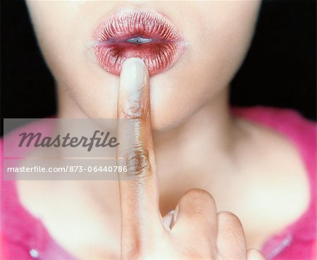 Woman with Finger to Mouth Stock Photo - Rights-Managed, Image code: 873-06440786